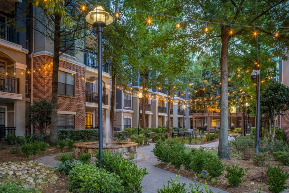 Lit walkway with trees at Marquis Midtown District in Atlanta, Georgia