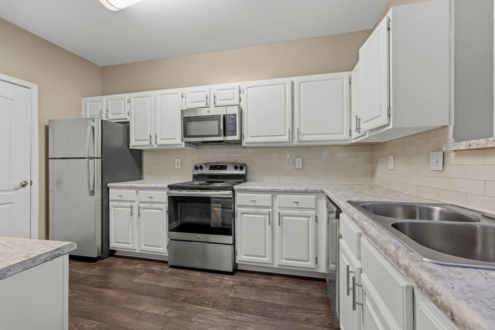 kitchen with white cabinets at The Marq at Brookhaven in Atlanta, Georgia