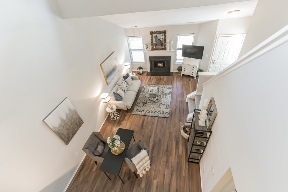 Overlooking living room area from second story landing at Eagle Rock Apartments at Columbia in Columbia, Maryland