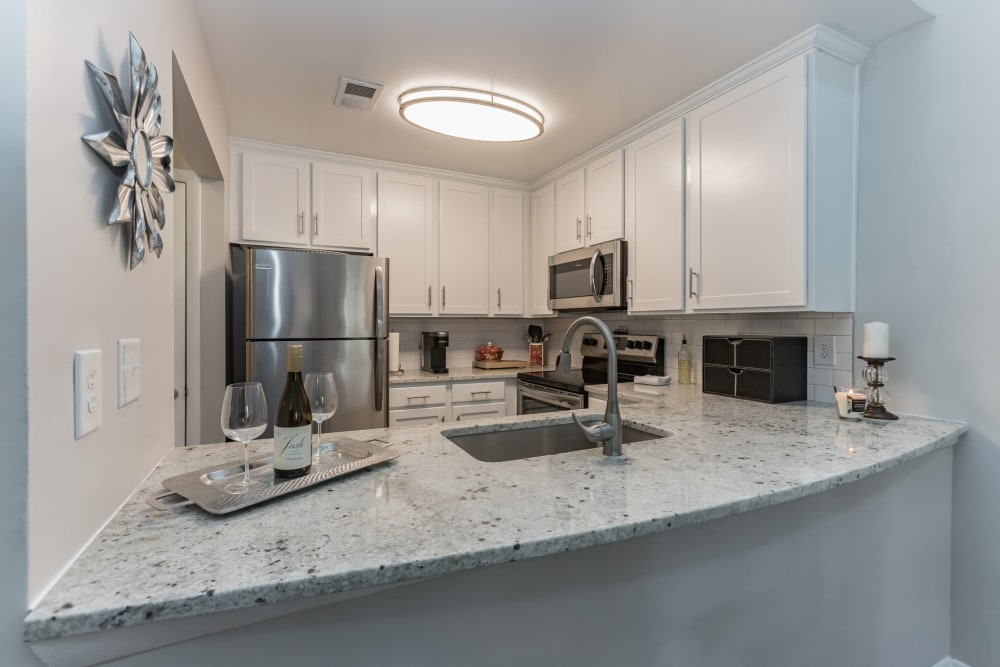 Granite island counter in model kitchen at Eagle Rock Apartments at Columbia in Columbia, Maryland