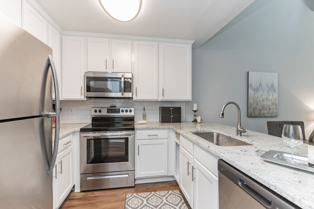 Model kitchen with white cabinetry at Eagle Rock Apartments at Columbia in Columbia, Maryland