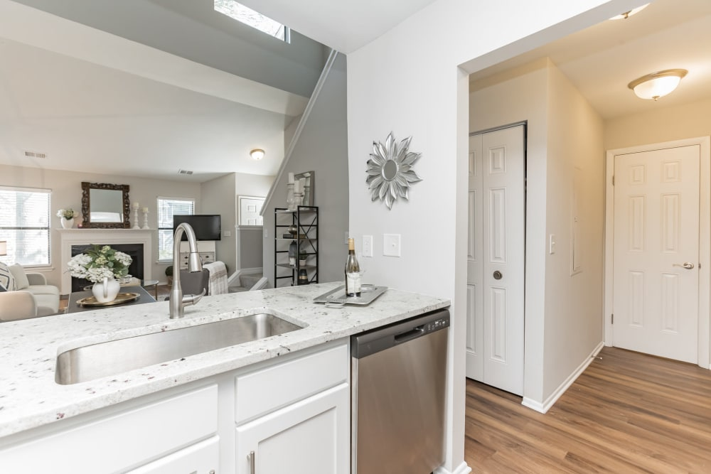 Model kitchen overlooking living room at Eagle Rock Apartments at Columbia in Columbia, Maryland
