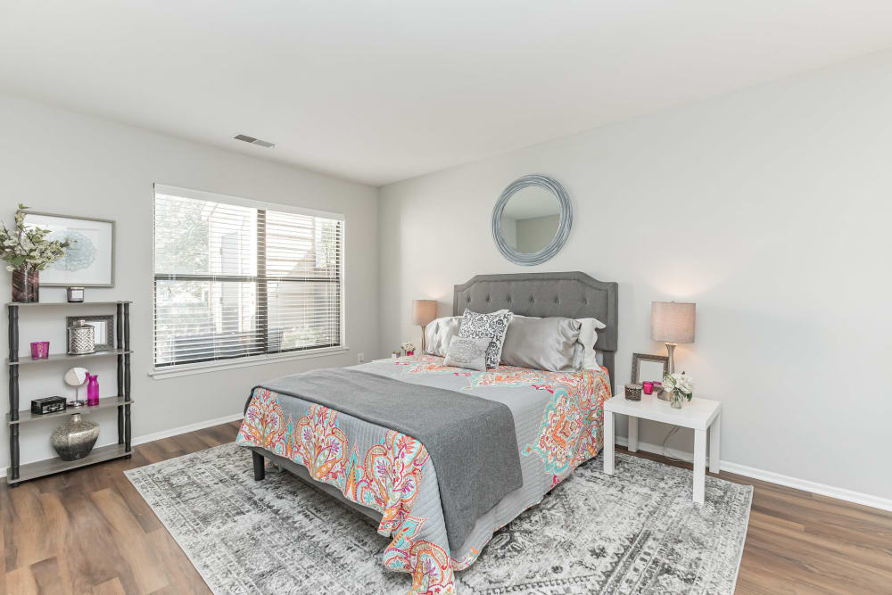 Spacious bedroom with wood flooring and big window at Eagle Rock Apartments at Columbia in Columbia, Maryland