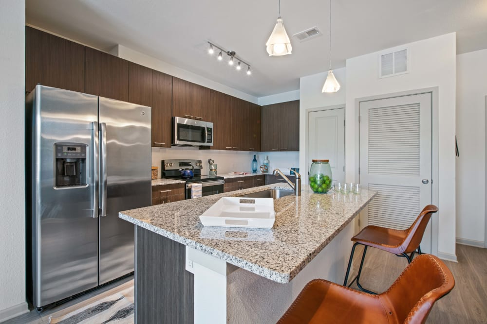 A beautiful kitchen with an island at Linden Crossroads in Orlando, Florida
