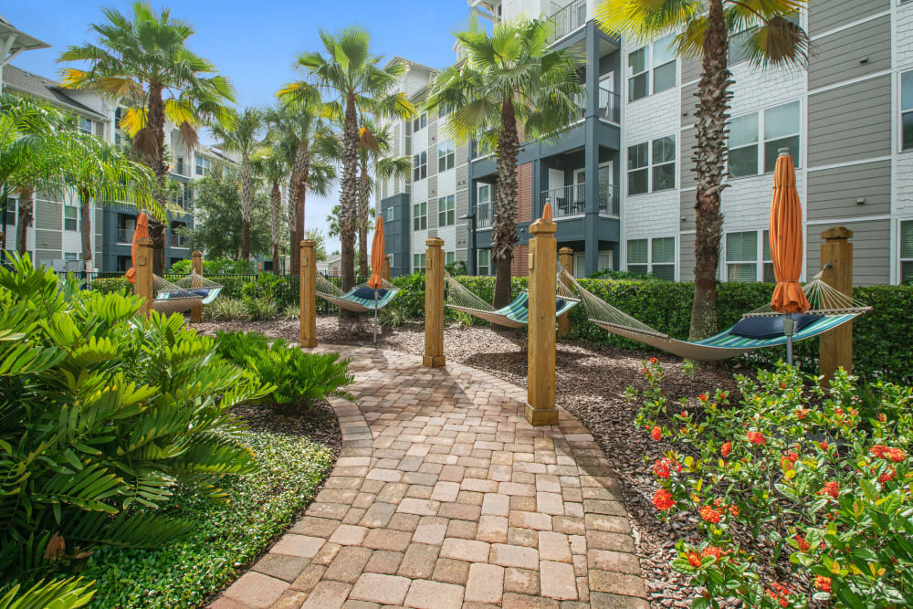 A scenic, green walkway at Linden Crossroads in Orlando, Florida