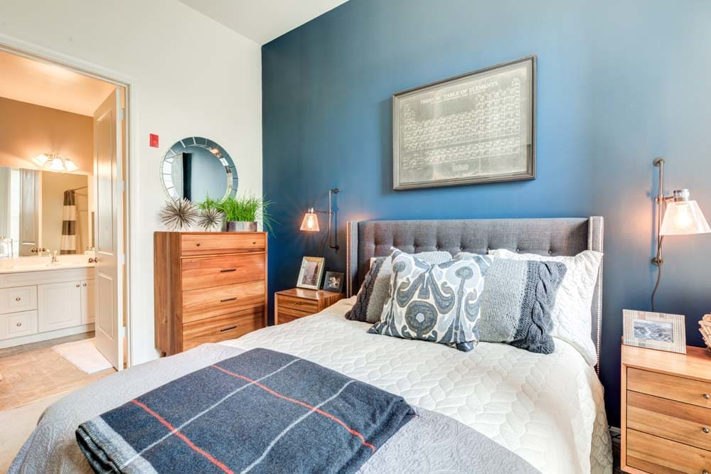 bedroom with an accent wall at Bradlee Danvers in Danvers, Massachusetts