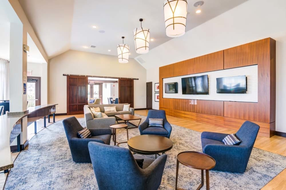 Community space and sitting area inside spacious clubhouse at The Grove Somerset in Somerset, New Jersey