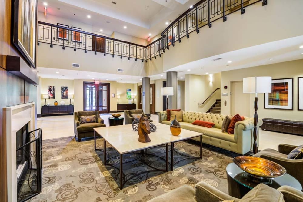 Well decorated community clubhouse with high ceilings and plenty of sitting spaces at The Grove Somerset in Somerset, New Jersey
