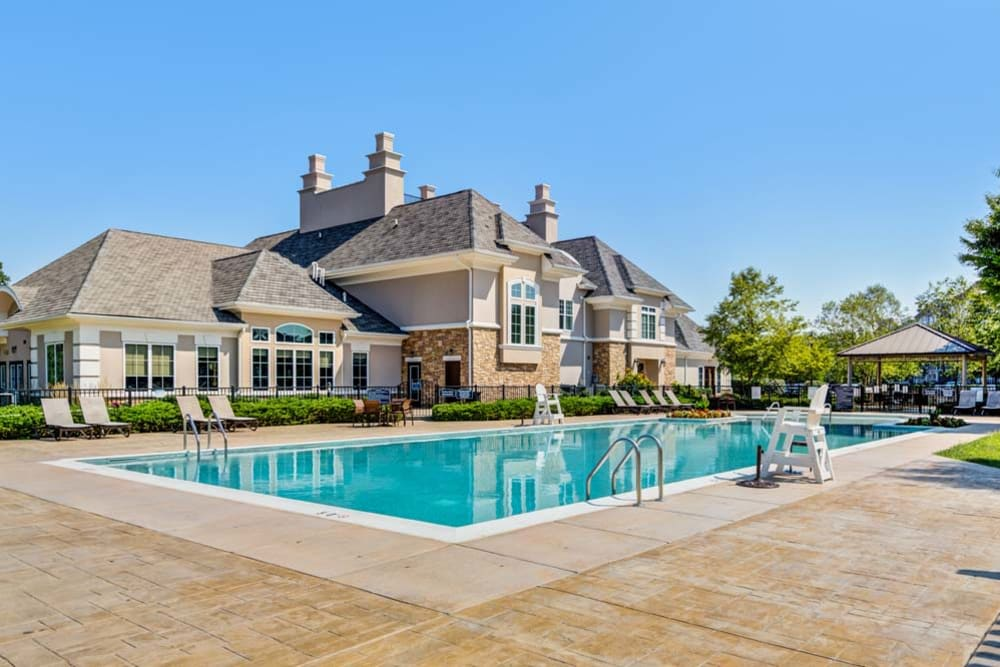 Outdoor community pool and clubhouse at The Grove Somerset in Somerset, New Jersey