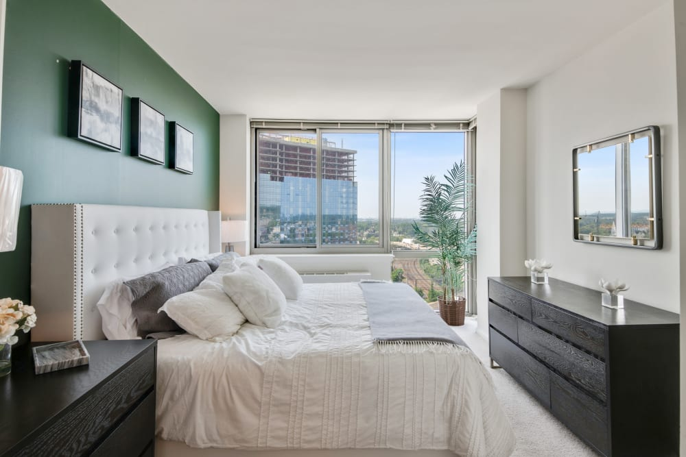Bedroom with large sliding door at Skyline New Rochelle