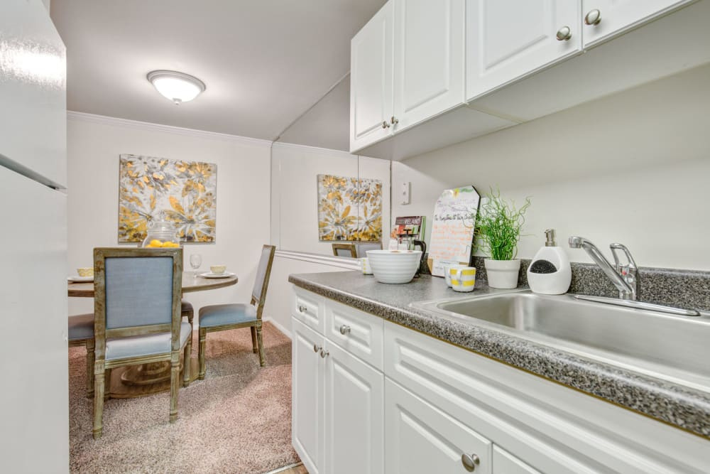 View of dining nook from kitchen at The Hamptons at Town Center in Germantown, Maryland