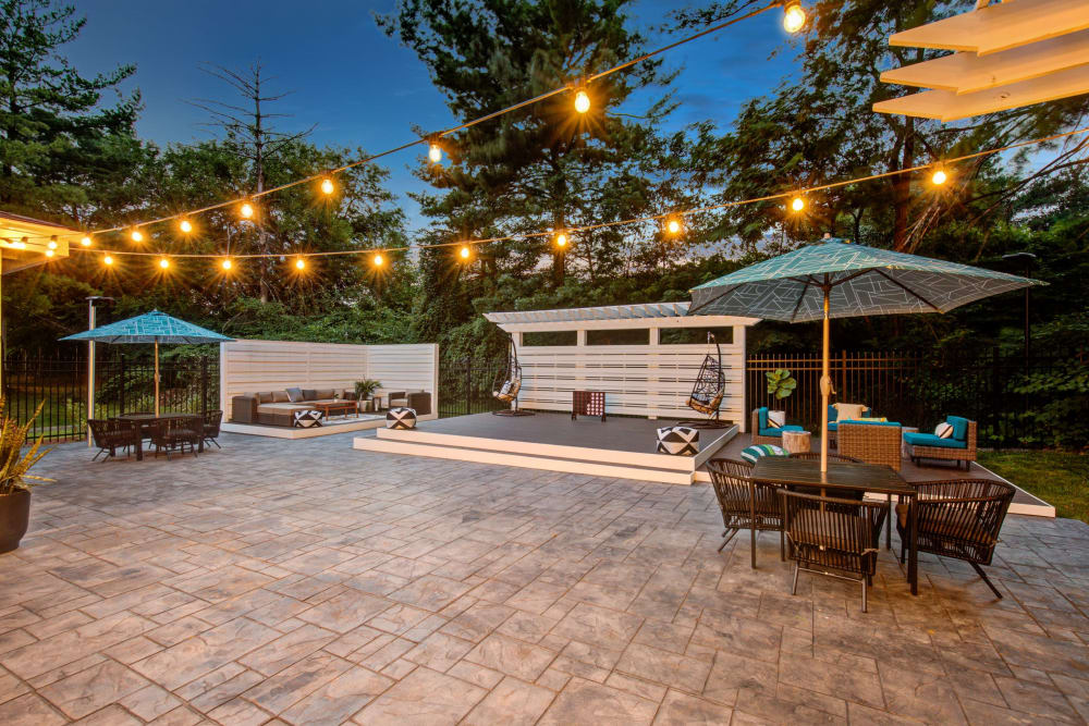 String lights on patio at The Hamptons at Town Center in Germantown, Maryland