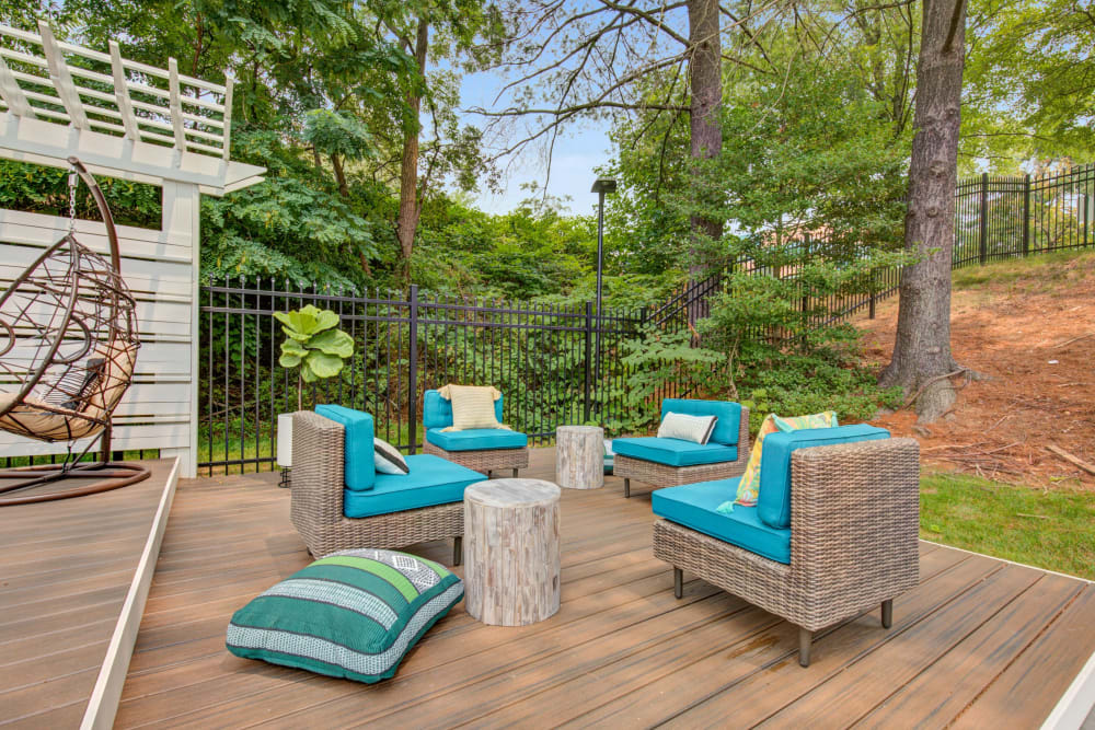 Outdoor lounge chairs on deck at The Hamptons at Town Center in Germantown, Maryland