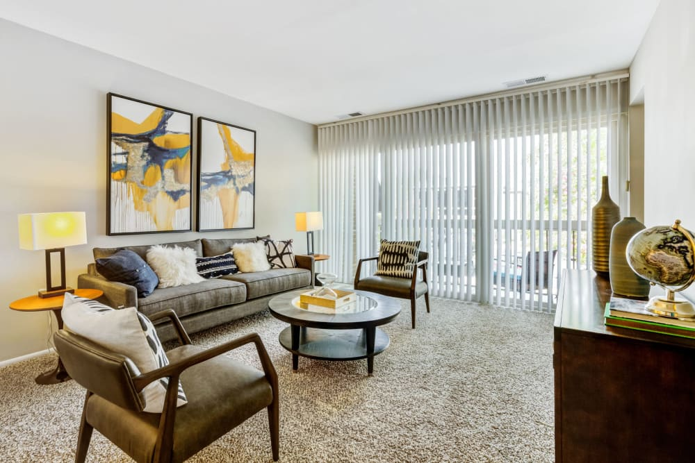 Model living room with sliding door at Cinnamon Run at Peppertree Farm in Silver Spring, Maryland