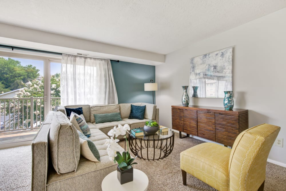 Well decorated model living room at Country Village Apartments in Bel Air, Maryland