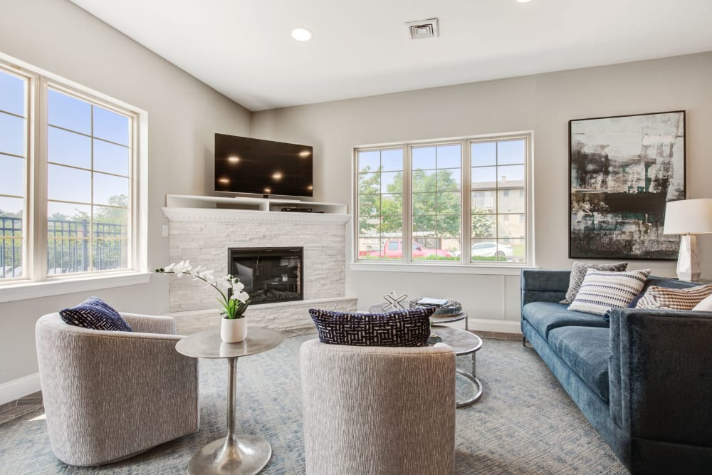 Clubhouse lounge with TV and fireplace at Country Village Apartments in Bel Air, Maryland