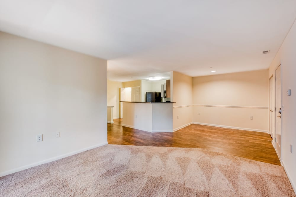 Interior vacant apartment home with dining area and open kitchen at Park at Winterset Apartments in Owings Mills, Maryland