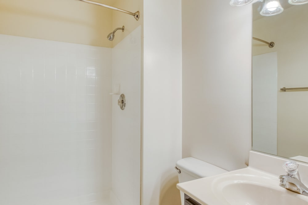 Bathroom with white countertops at Park at Winterset Apartments in Owings Mills, Maryland