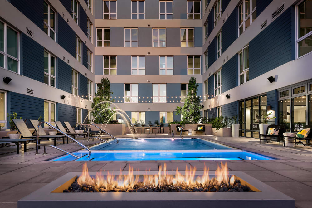 Swimming pool with a sundeck and chairs at Hudson on Farmer in Tempe, Arizona