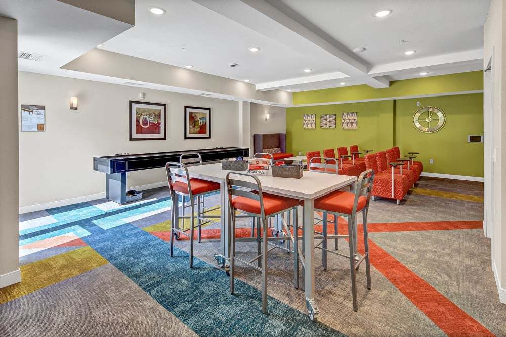 Community game and media room at Novo Apartments in Richfield, Minnesota