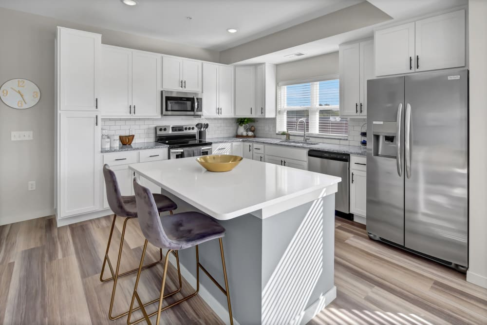 Open kitchen with large center island at Novo Apartments in Richfield, Minnesota