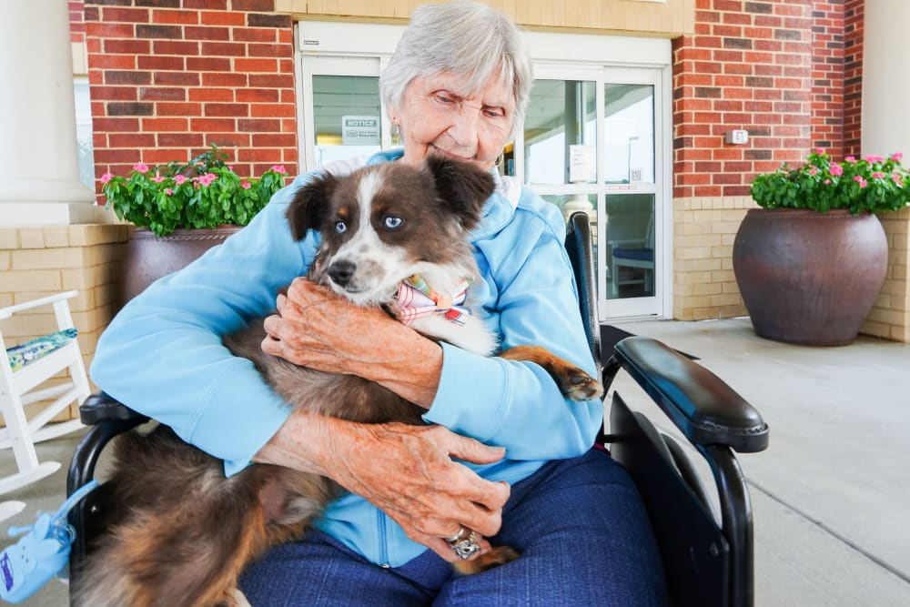 Resident and her pet The Harmony Collection at Hanover in Mechanicsville, Virginia