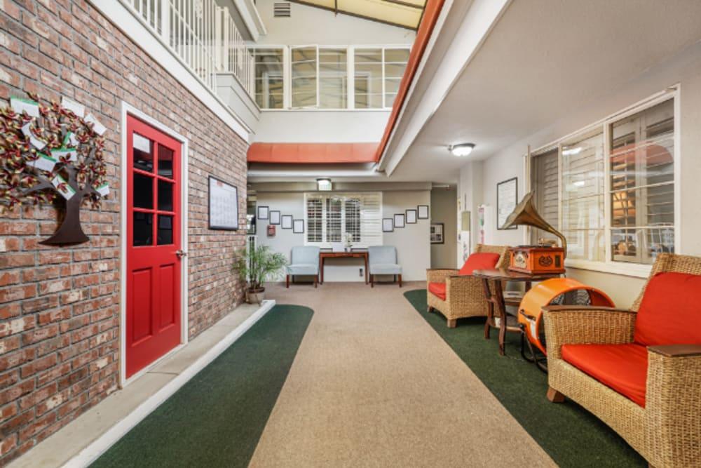 Interior hallway with a brick accent wall at Meridian at Ocean Villa & Bella Mar in Santa Monica, California