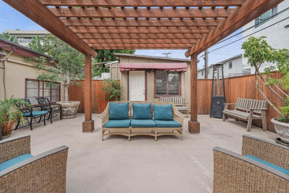 Partially covered patio with couches at Meridian at Ocean Villa & Bella Mar in Santa Monica, California