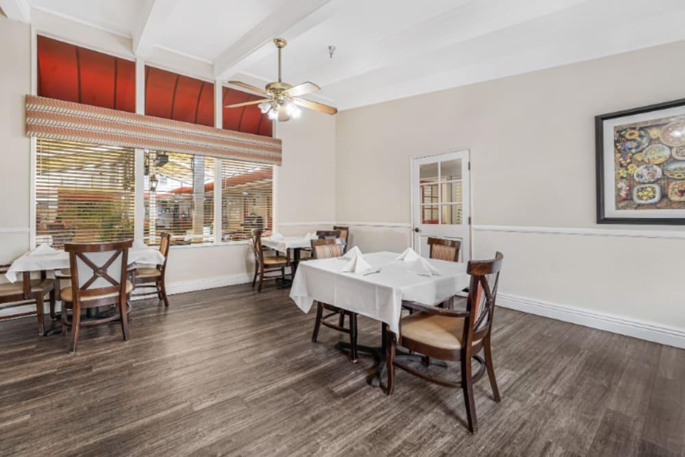 Dining area near large windows at Meridian at Ocean Villa & Bella Mar in Santa Monica, California