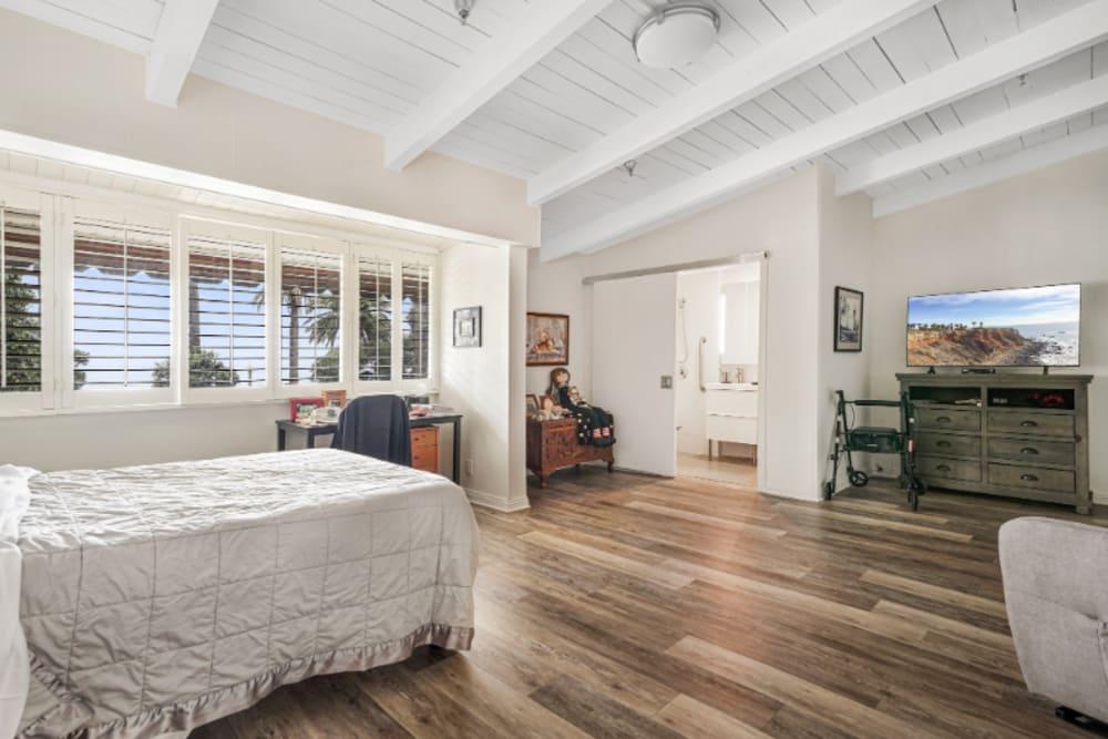 Bed next to a long row of windows at Meridian at Ocean Villa & Bella Mar in Santa Monica, California