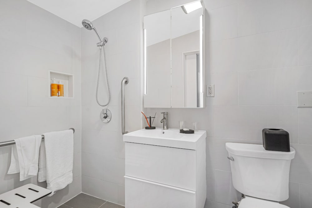 Bathroom with a walk in shower at Meridian at Ocean Villa & Bella Mar in Santa Monica, California