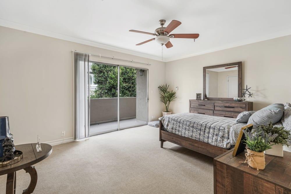 Spacious bedroom with a sliding glass door at Meridian at Ocean Villa & Bella Mar in Santa Monica, California