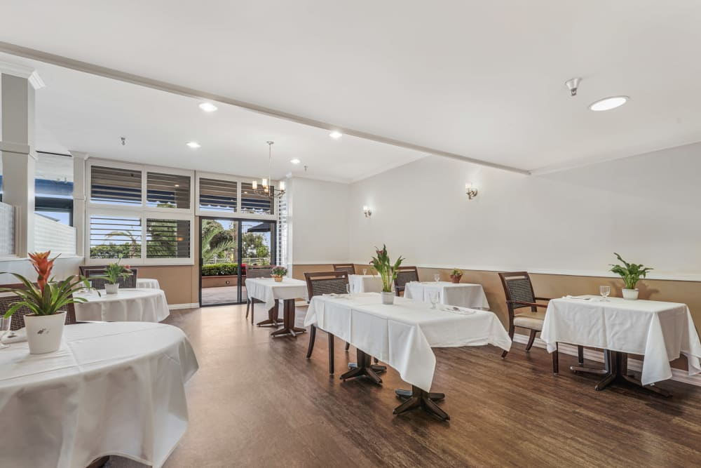 Community dining area with wood style floors at Meridian at Ocean Villa & Bella Mar in Santa Monica, California