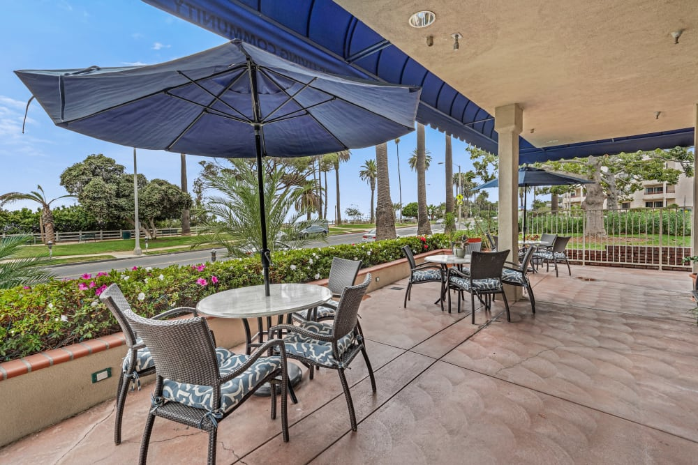 Covered patio surrounded by flowers at Meridian at Ocean Villa & Bella Mar in Santa Monica, California