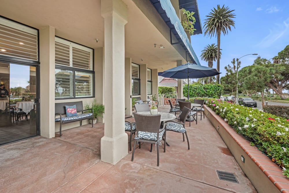 Patio with tables and chairs at Meridian at Ocean Villa & Bella Mar in Santa Monica, California