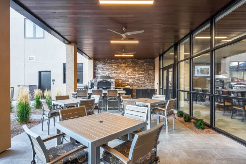 Covered patio with seating at Amaran Senior Living in Albuquerque, New Mexico