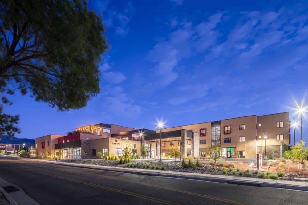 Panoramic exterior view of Amaran Senior Living at dusk in Albuquerque, New Mexico