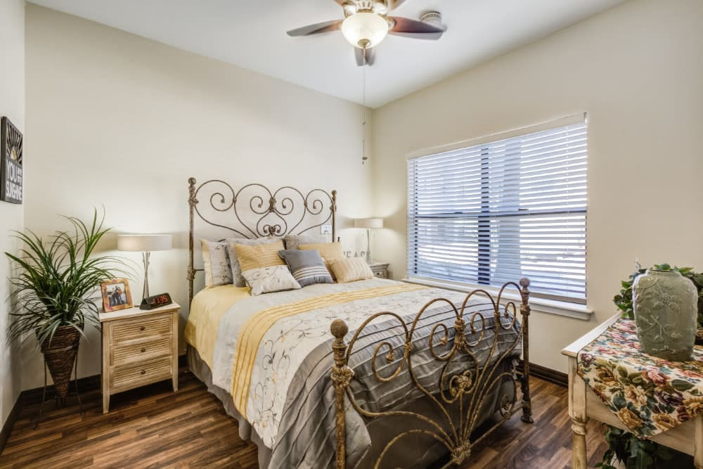 Bedroom with a ceiling fan at Truewood by Merrill, Scottsdale in Scottsdale, Arizona
