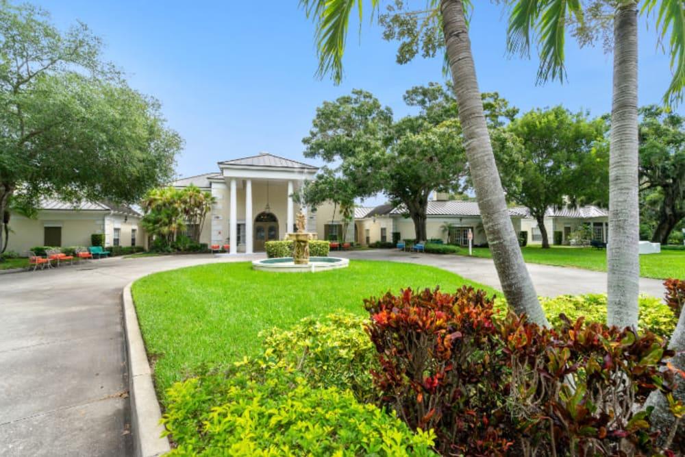 Long driveway leading to front entrance at Truewood by Merrill, Bradenton in Bradenton, Florida