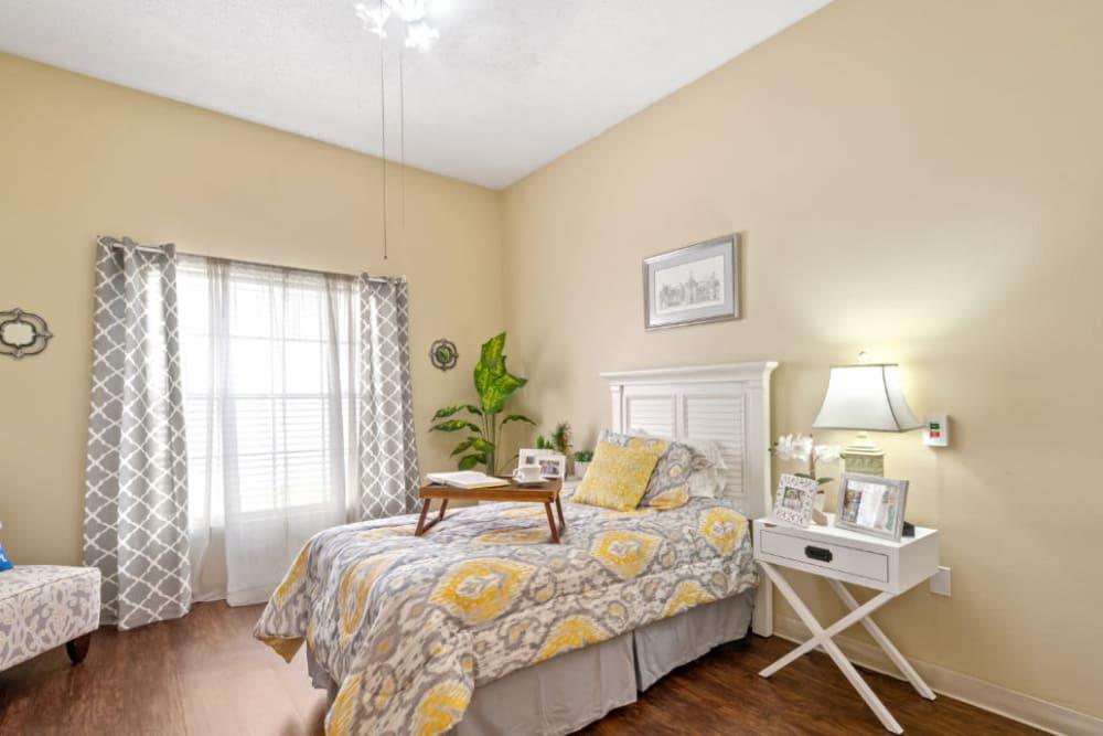 Bedroom with wood style floors at Truewood by Merrill, Bradenton in Bradenton, Florida
