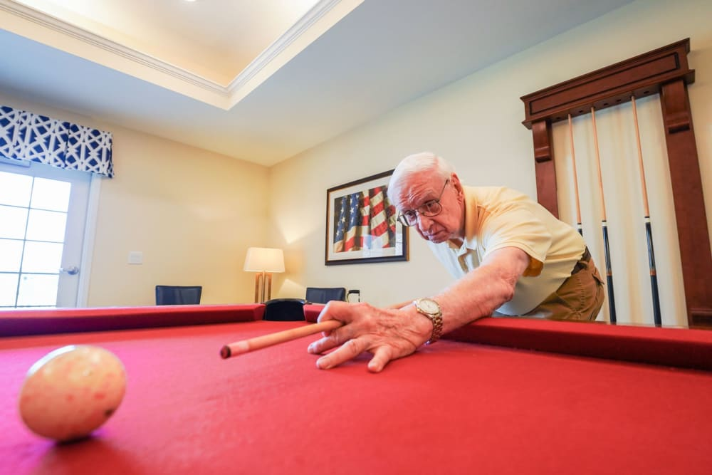 Resident playing pool Harmony at Victory Station in Murfreesboro, Tennessee