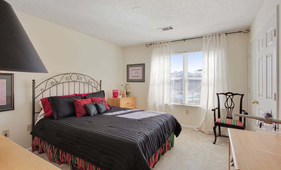Bright bedroom with a large window at Wellington Point in Atlanta, Georgia