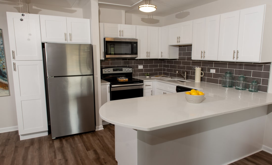 Sleek, modern kitchen at Mandalane Apartments in Wheeling, Illinois