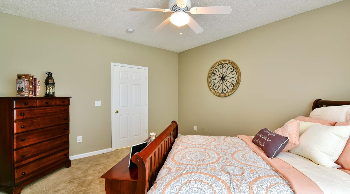 Spacious bedroom with a ceiling fan at Hunter's Run in Macon, Georgia