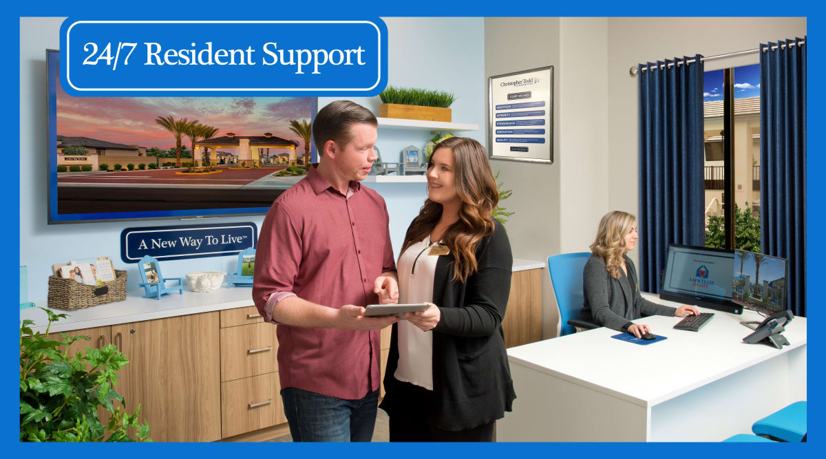 Resident chatting with one of the leasing office staff at Christopher Todd Communities On Happy Valley in Peoria, Arizona