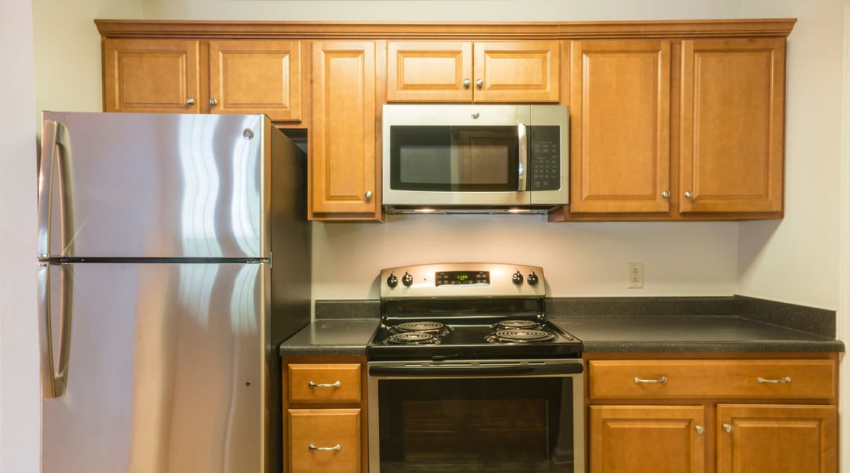 Kitchen with stainless-steel appliances at Glade Creek Apartments in Roanoke, Virginia