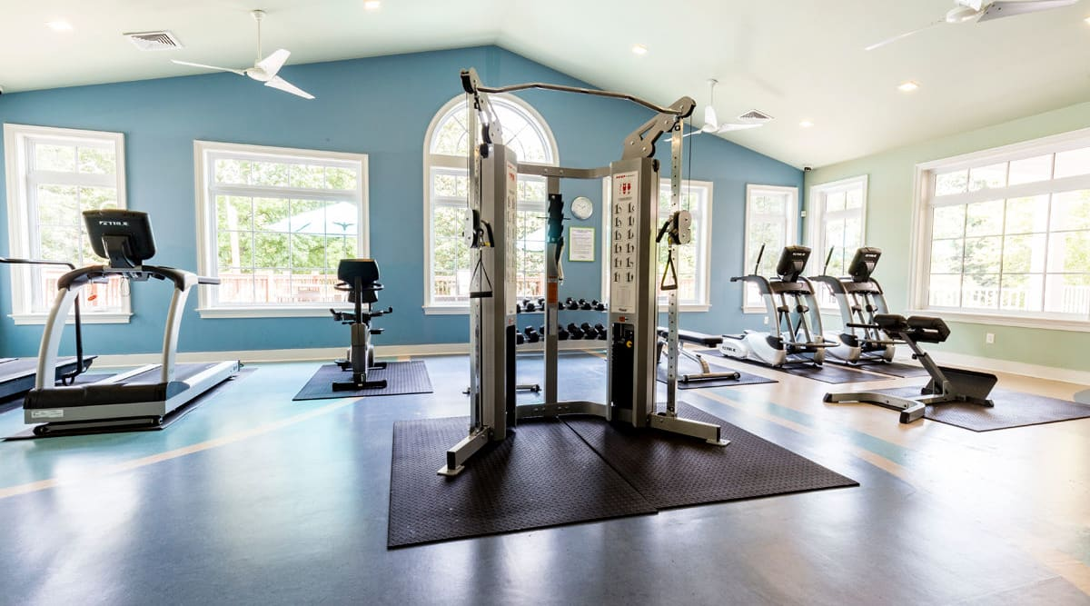 Fitness center with treadmills at Harbor Village Apartments in Richmond, Virginia
