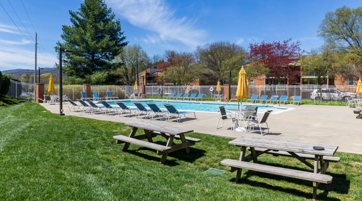 Picnic tables by pool at The Crest Apartments in Salem, Virginia