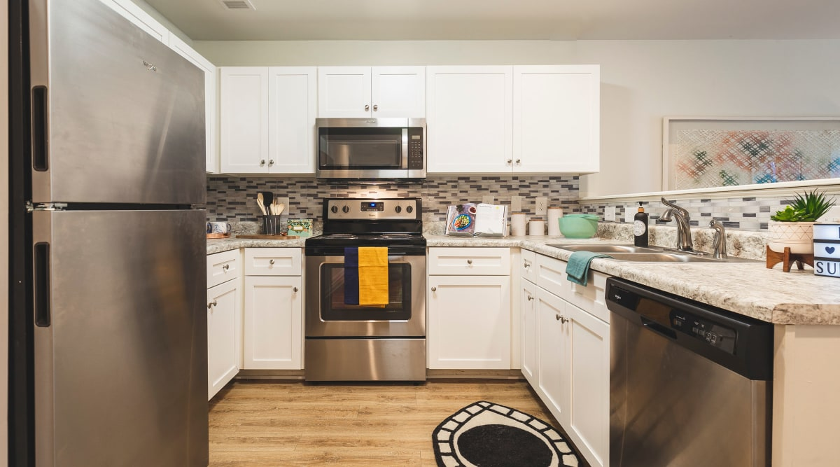 Kitchen with stainless-steel appliances at Sunchase at James Madison in Harrisonburg, Virginia