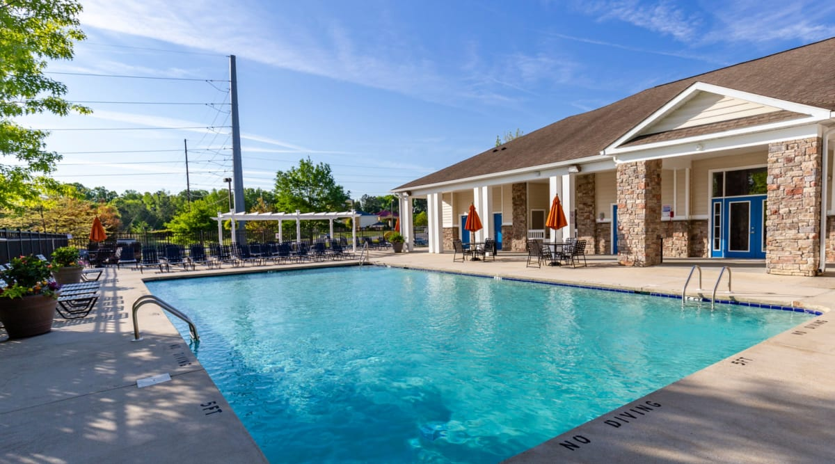 Sparkling swimming pool at Sunchase Apartments in Greenville, North Carolina